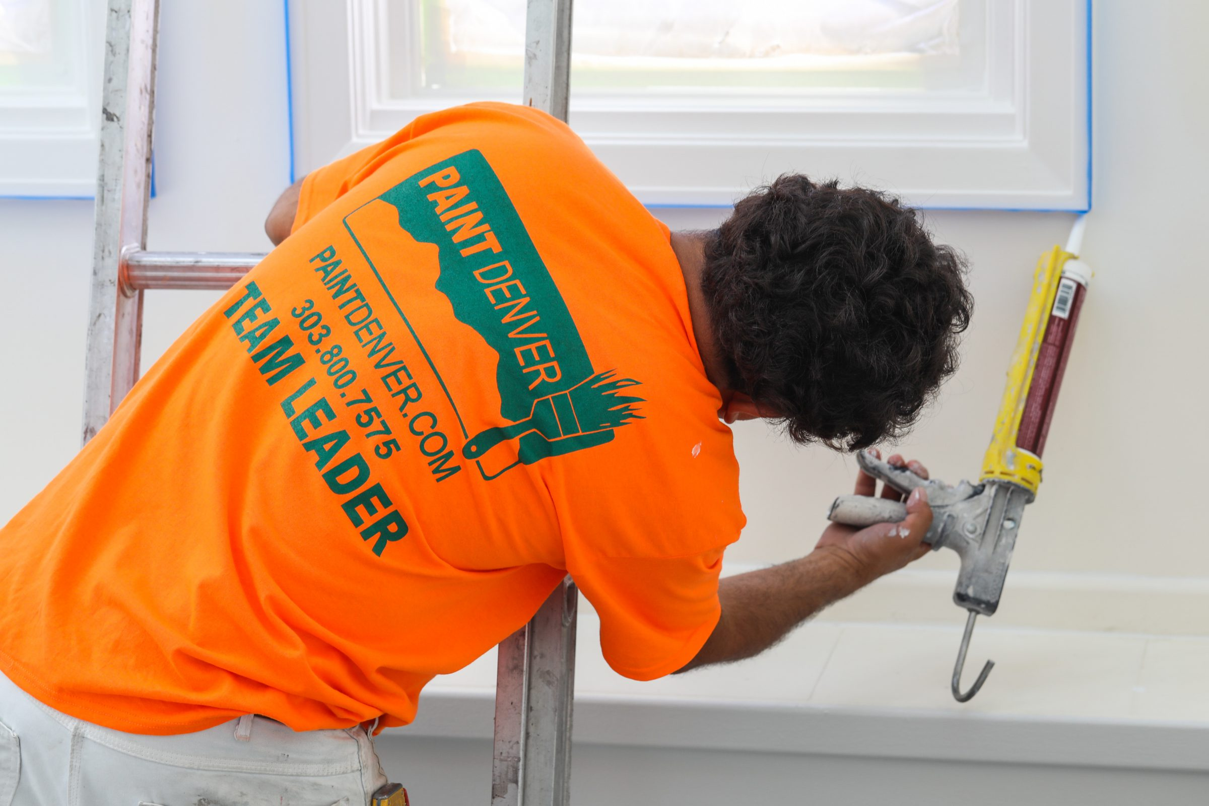 painter denver team working on caulking a home interior after project is completed